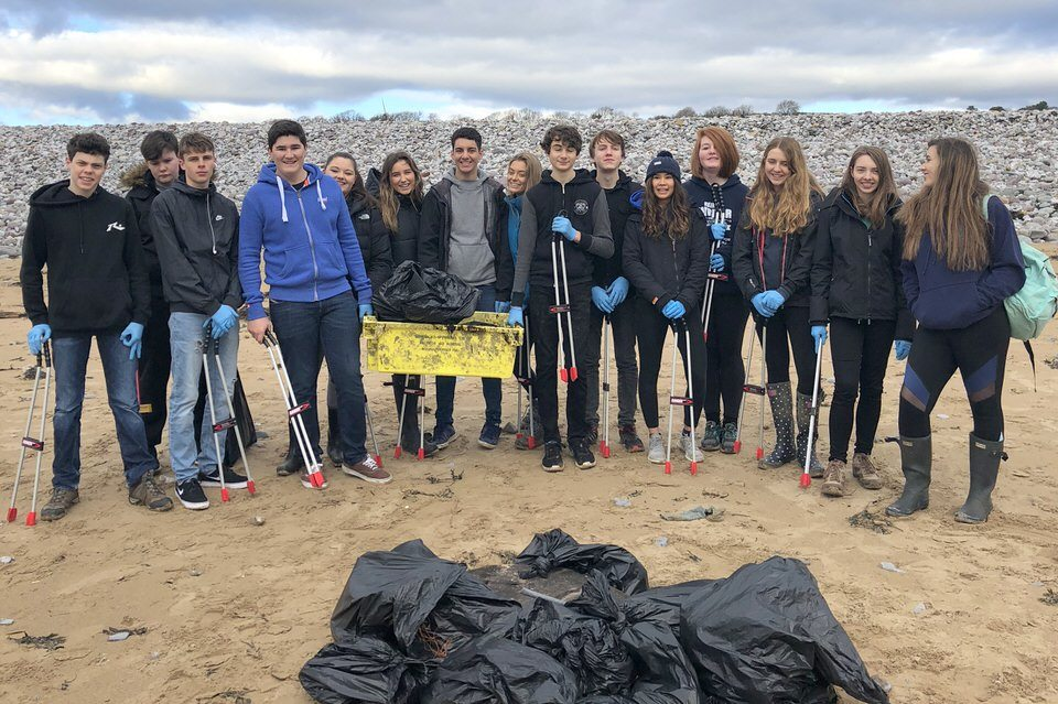 Students from St Clare's independent private school on Newton Beach with the rubbish they have collected